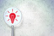 Finance concept:  Light Bulb with optical glass on digital backg