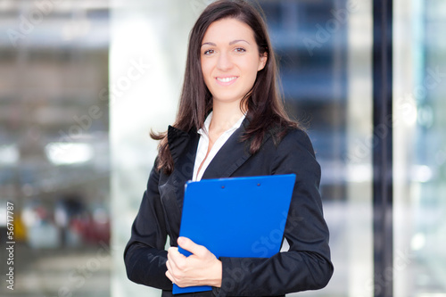 Beautiful young female executive outdoor