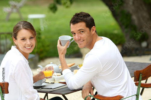 Romantic breakfast in hotel garden