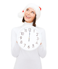 woman in santa helper hat with clock showing 12