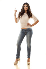 attractive woman in jeans  touching imaginary object