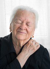 Senior woman suffering from shoulder ache