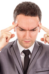 Closeup portrait of  a young business man with headache rubbing