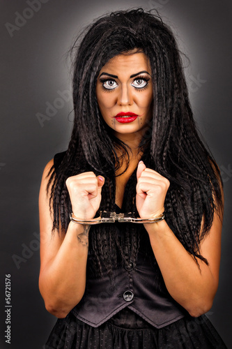 Portrait of an expressive young woman with handcuffs-creative ma