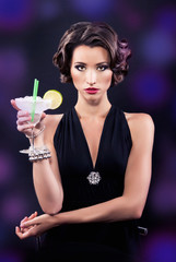 Beautiful elegant girl with a martini glass
