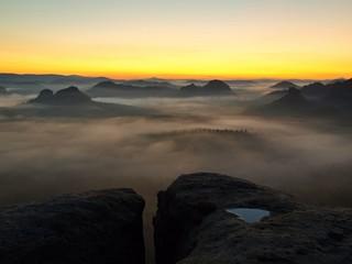 Sandstone peaks increased from foggy background.