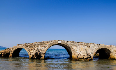 Sureal bridge on the sea
