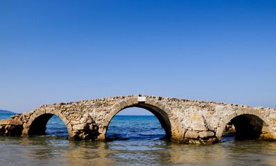 Sureal bridge on the sea