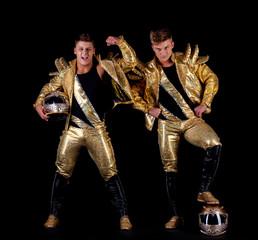Handsome guys posing in golden dancing costumes