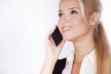 Portrait of happy smiling young businesswoman with phone, isola