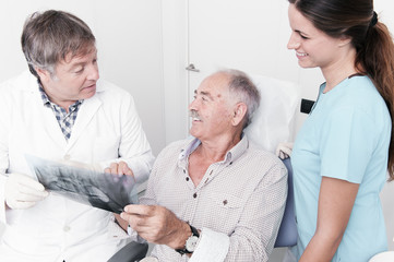 elderly gentleman, discussing with his dentist x-ray results