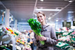 Pretty, young woman shopping for fruits and vegetables