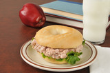 Tunafish sandwich on a bagel with schoolbooks poster