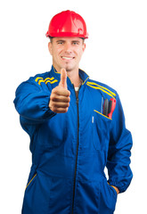 Handsome mechanic with hard hat and tools