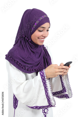 Beautiful arab woman browsing her smart phone