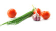 Mediterranean food ingredients: spring onions, garlic and tomato