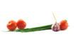 Mediterranean food ingredients: spring onions, garlic and tomato