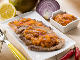 grilled steak with mango sauce