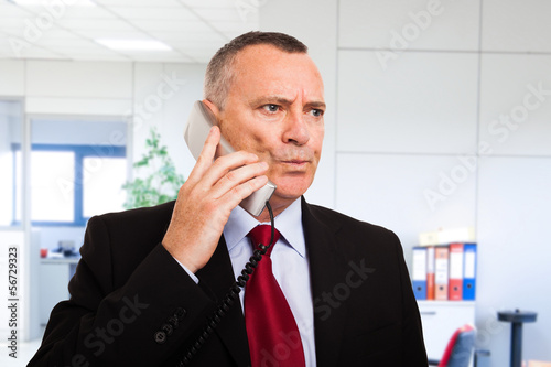 Perplexed businessman talking on the phone