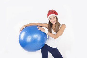Christmas fitness woman in santa hat