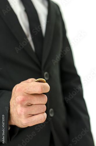 Detail of businessman tossing a coin.