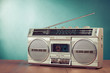 Retro ghetto blaster on table in front mint green background - 56730309