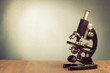 Vintage microscope on table for science background - 56730314