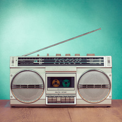 Retro radio and cassette stereo recorder on mint green