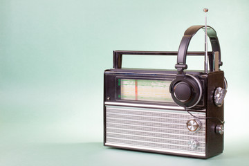 Old retro radio and headphones conceptual photo