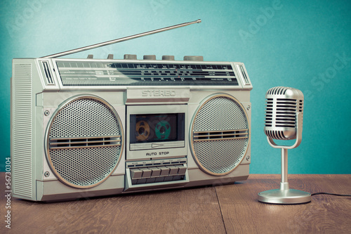 Retro radio and cassette player, microphone on table