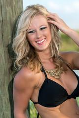 Joyful caucasian woman in bikini