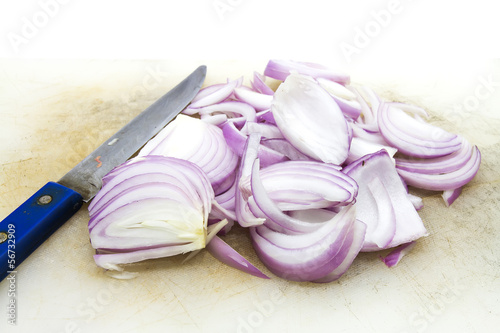 Sliced Red Onion with Knife and Chopping Block.