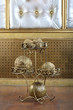 Metal stand with golden balls decorative element in the interior