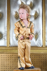 Portrait of a little boy in pop retro suit