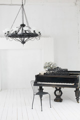 A beautiful chandelier and a piano