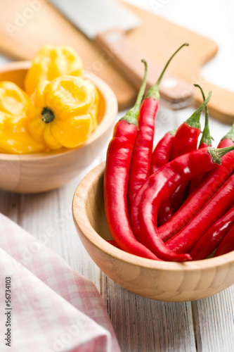 red peppers and habanero in bowls