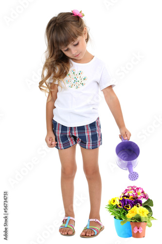 Little girl watering beautiful flowers isolated on white