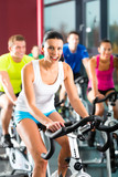 Young People doing sport Spinning in gym for fitness