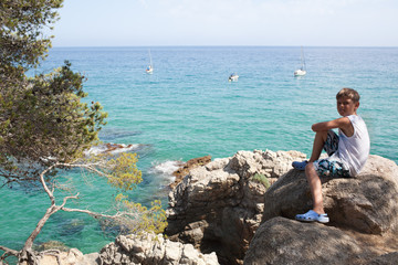 Young boy and beautiful Mediterranean seascape