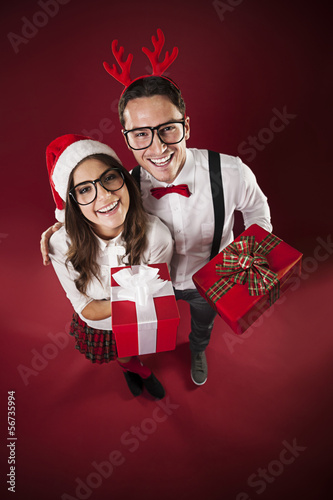 Portrait of funny couple with christmas presents