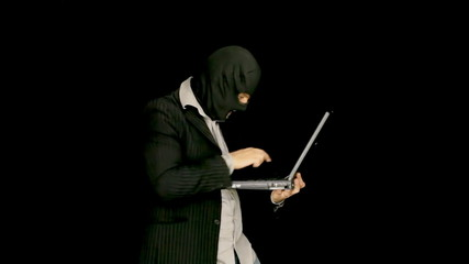 Masked criminal laptop cybercrime