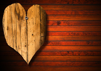 Wooden Heart on Brown Wood Background