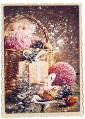Vintage Christmas Card with Gifts and falling snow, vintage tone