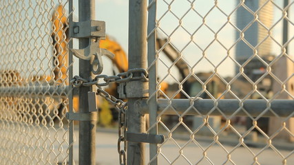Locked gate at worksite. Heavy Machinery.