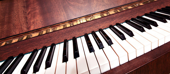 Detail of traditional black and white keys on music keyboard