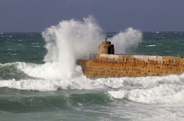 Portreath pier big wave splash, Cornwall England.