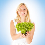 happy woman holding green salad