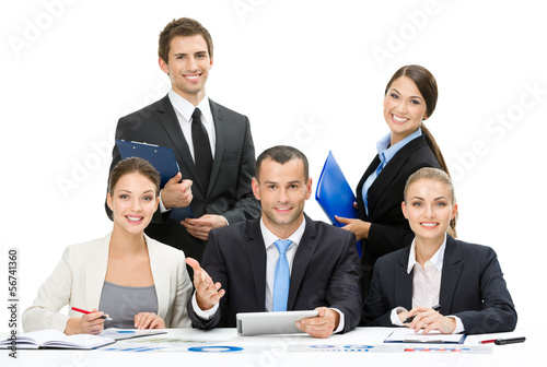 Group of business people working while sitting at the table