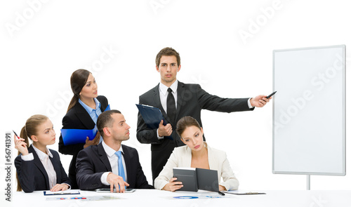 Manager showing something on screen to the group of managers