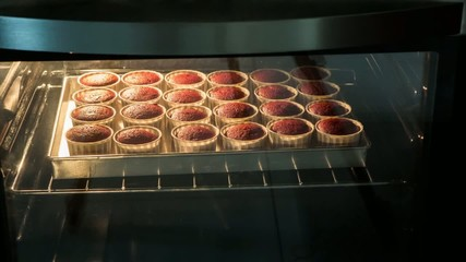 Cupcakes baking in the oven time lapse